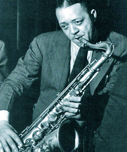 A relatively youthful Lester Young, holding his tenor sax like a flute, which is in fact the sound he was after.